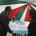 Eudiah Maru Masters candidate receves cheque from VC Moi University